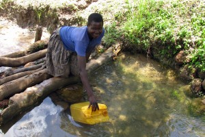 Fetching Drinking Water In A Jerrycan In Uganda