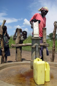 Pumping Drinking Water From A New Well in Uganda
