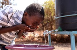 Kenyan Child Gets Clean Drinking Water
